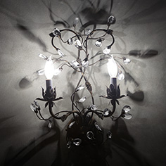From https://www.arhaus.com/furniture/lighting/sconces/claudette-iron-wall-sconce-in-rustic-silver/
